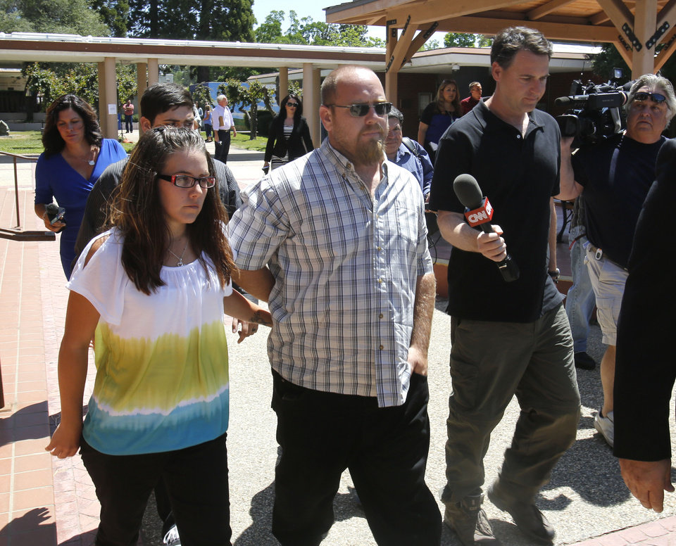 Photo - Barney Fowler, the father of murder victim Leila Fowler, leaves the Calaveras County Courthouse after the arraignment of his 12-year-old son for the murder of  Leila, in San Andreas, Calif., Wednesday, May 15, 2013.  Leila Fowler, 8, was stabbed to death in her Valley Springs home, last month.  The defendant was charged with second-degree murder and a special allegation for use of a dangerous weapon for the death of Leila Fowler. No plea was entered. (AP Photo/Rich Pedroncelli)