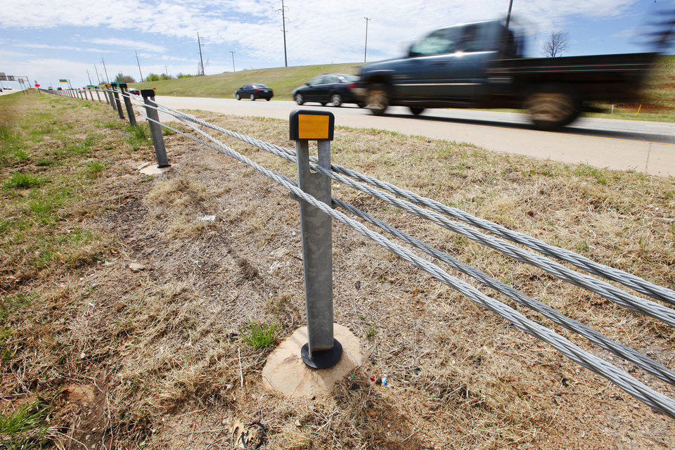 Photo - Vehicles speed past a cable barrier in the median of State Highway 74 on the Lake Hefner Parkway in Oklahoma City. Photo by Paul B. Southerland, The Oklahoman