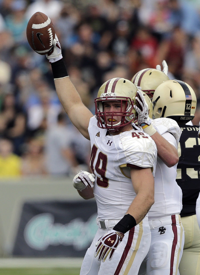 Photo -   Boston College linebacker Steele Divitto (49) reacts after recovering an Army fumble during the first half of an NCAA college football game Saturday, Oct. 6, 2012, in in West Point, N.Y. (AP Photo/Mike Groll)