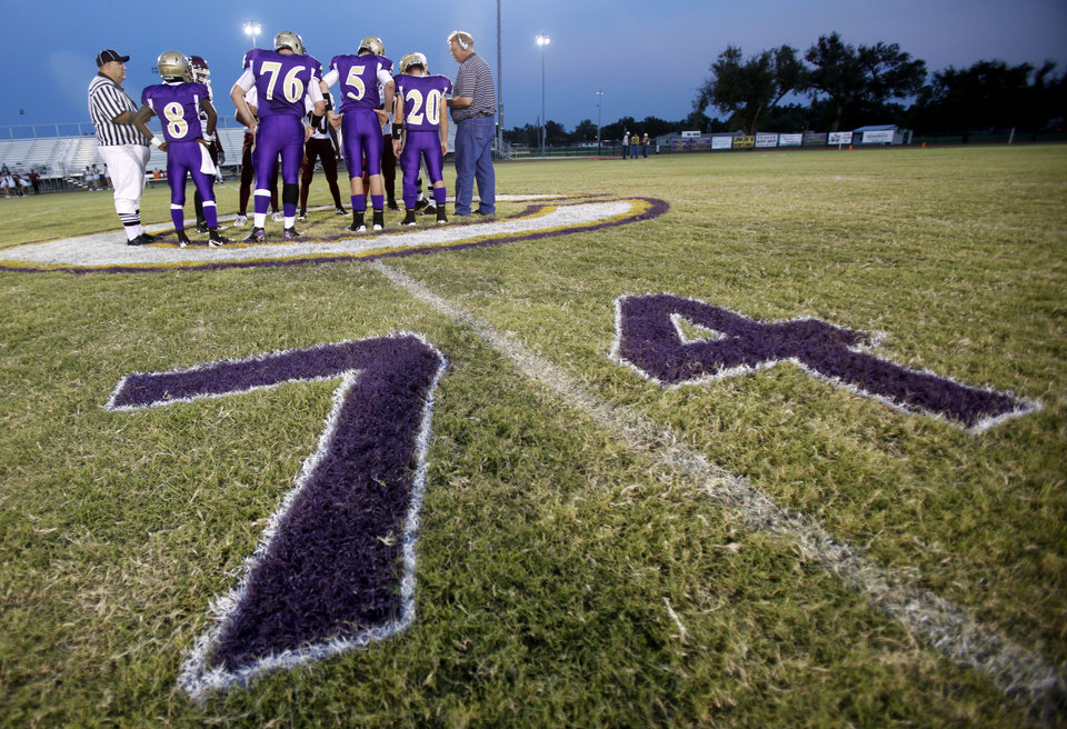 The coin toss before the football game between Chickasha and Capitol Hill at Chickasha High School, Friday, Oct. 1, 2010. It was the first home game since the death of player Kody Turner. Photo by Sarah Phipps, The Oklahoman