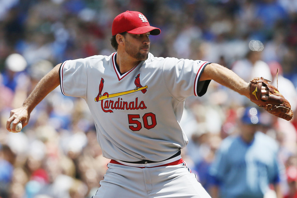 Photo - St. Louis Cardinals starting pitcher Adam Wainwright delivers against the Chicago Cubs during the first inning of a baseball game on Sunday, July 27, 2014, in Chicago. (AP Photo/Andrew A. Nelles)