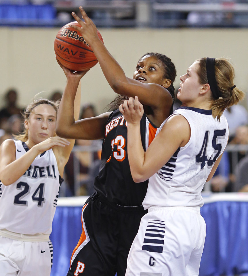 Photo - Preston guard Ki-Essence Shields pushes her way between Cordell defenders Cherokee Mitchell, left, and Gabbie Parsons during the Class 2A Girls State Championship game between Preston and Cordell at Jim Norick Arena at State Fair Park  on Saturday, Mar. 15, 2014.  Preston won,  45-41. Photo by Jim Beckel, The Oklahoman
