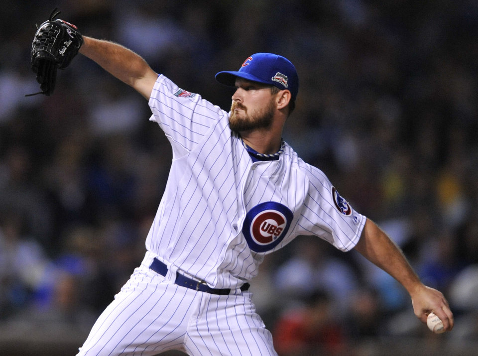Photo - Chicago Cubs starter Travis Wood delivers a pitch during the first inning of a baseball game against the Pittsburgh Pirates in Chicago, Saturday, June 21, 2014. (AP Photo/Paul Beaty)