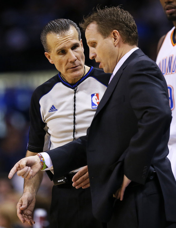 Photo - Oklahoma City head coach Scott Brooks talks with official Ken Mauer during an NBA basketball game between the Oklahoma City Thunder and the Dallas Mavericks at Chesapeake Energy Arena in Oklahoma City, Monday, Feb. 4, 2013. Photo by Nate Billings, The Oklahoman