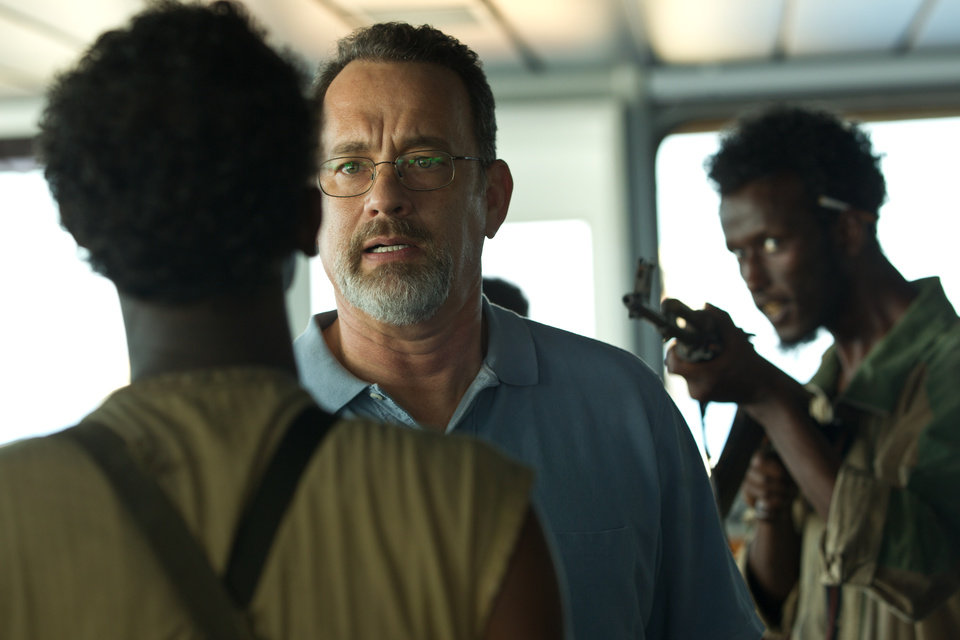 Photo - This film image released by Sony - Columbia Pictures shows Tom Hanks, center, in
