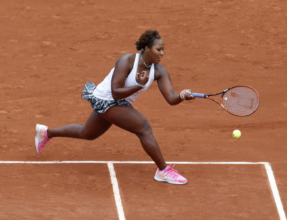 Photo - Taylor Townsend, of the U.S, returns the ball to France's Alize Cornet during their second round match of  the French Open tennis tournament at the Roland Garros stadium, in Paris, France, Wednesday, May 28, 2014. (AP Photo/Darko Vojinovic)