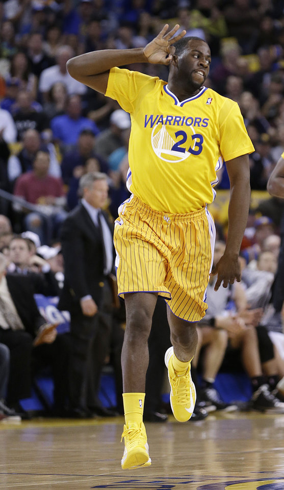 Golden State Warriors' Draymond Green celebrates after scoring against the San Antonio Spurs during the first half of an NBA basketball game Friday, Feb. 22, 2013, in Oakland, Calif. (AP Photo/Ben Margot)