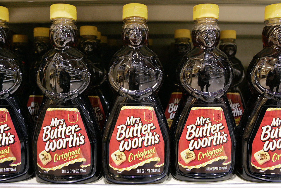 Photo - FILE - In a Monday, Feb. 12, 2007, file photo, bottles of Mrs. Butterworth's Original Syrup are displayed in a store, in Princeton, N.J. Hillshire Brands is buying Pinnacle Foods, whose brands include Duncan Hines and Mrs. Butterworth's, in a cash-and-stock deal valued at approximately $4.23 billion, the companies announced Monday, May 12, 2014. Hillshire Brands' roster of brands include Jimmy Dean meats, Ball Park hot dogs and Sara Lee frozen bakery goods. The combined company will use the Hillshire Brands name and be based in Chicago. (AP Photo/Mel Evans, File)