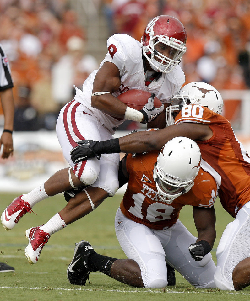 Photo - Oklahoma's Dominique Whaley (8) tries to get past Texas' Emmanuel Acho (18) and Alex Okafor (80) during the Red River Rivalry college football game between the University of Oklahoma Sooners (OU) and the University of Texas Longhorns (UT) at the Cotton Bowl in Dallas, Saturday, Oct. 8, 2011. Oklahoma won 55-17. Photo by Bryan Terry, The Oklahoman