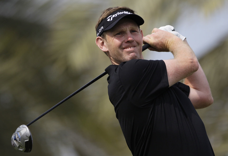 Stephen Gallacher from Scotland plays a shot off the 3rd tee during the final round of the Dubai Desert Classic golf tournament in Dubai, United Arab Emirates, Sunday Feb. 2, 2014. (AP Photo/Kamran Jebreili)