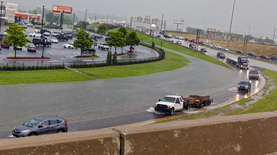 Photo - Traffic gets backed up on I-44 as flood waters overtake the exit to westbound I-40  in Oklahoma City, Okla. on Thursday, June 6, 2019. [Chris Landsberger/The Oklahoman]