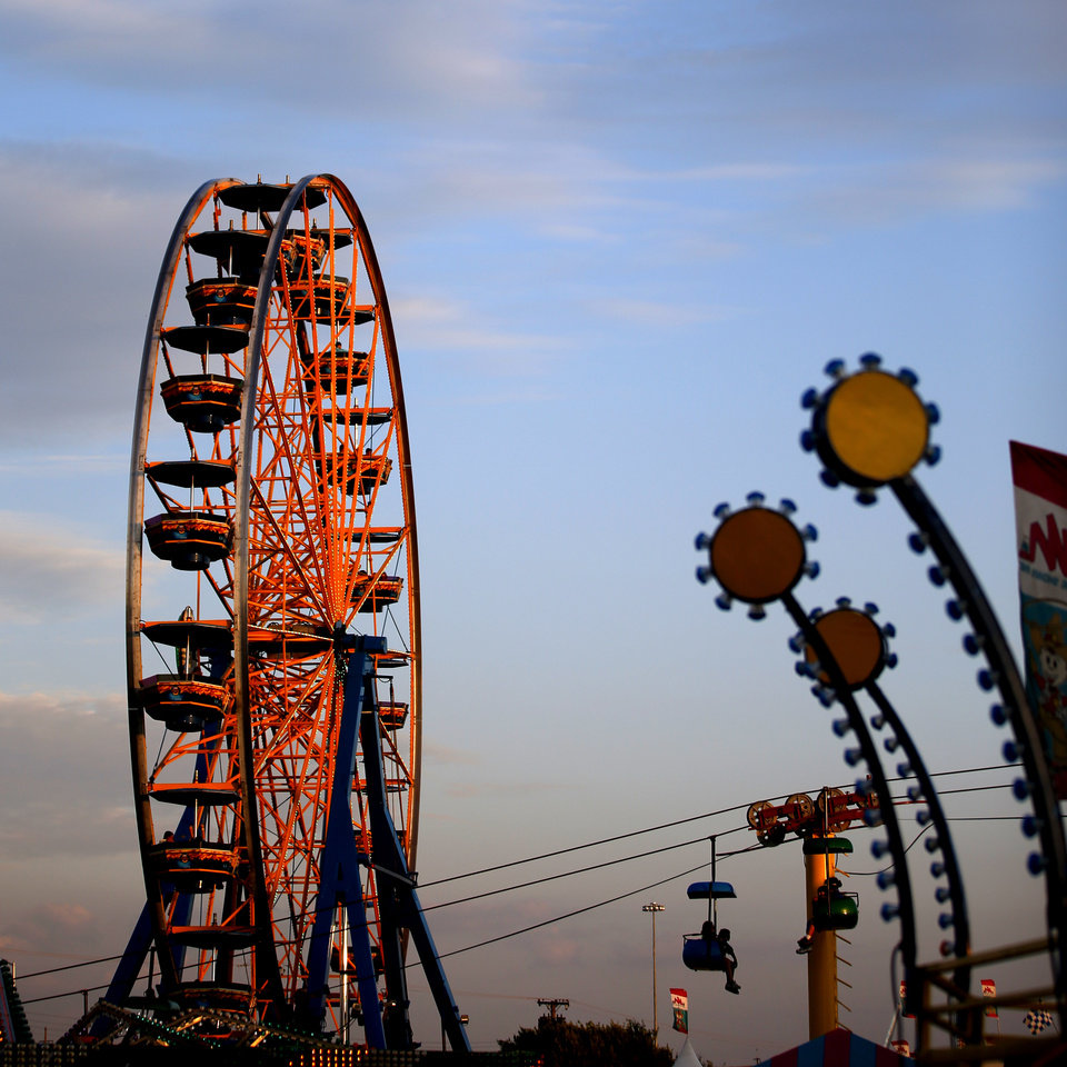 Visitors to the Oklahoma State Fair ride the Ferris wheel at dusk in Oklahoma City, Wednesday, Sept. 18, 2013. Photo by Bryan Terry, The Oklahoman