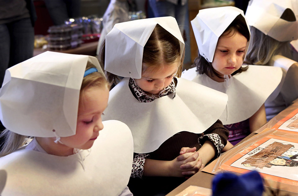 Kindergarten students in Soldier Creek Elementary School in Midwest City dressed as pilgrims and Indians as they celebrated a Thanksgiving meal in their classrooms on Tuesday, Nov. 20, 2012. Photo by Jim Beckel, The Oklahoman