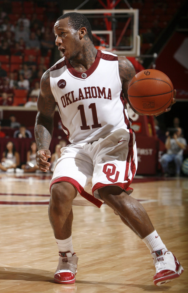 Photo - OU's Tommy Mason-Griffin (11) drives to the basket during the men's college basketball game between the University of Oklahoma and Iowa State, Wednesday, Jan. 27, 2010, at the Lloyd Noble Center in Norman, Okla. Photo by Sarah Phipps, The Oklahoman.  ORG XMIT: KOD
