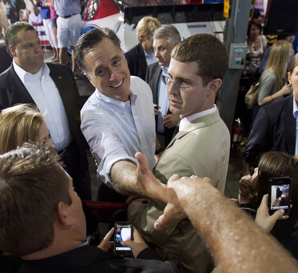 Photo -   Republican presidential candidate Mitt Romney, center, greets supporters at a rally Sunday, Aug. 12, 2012, in Mooresville, N.C., at the NASCAR Technical Institute. (AP Photo/Jason E. Miczek)