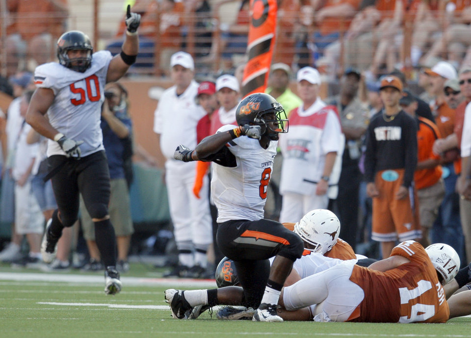 Oklahoma State\'s Daytawion Lowe (8) celebrates a fumble recovery as Texas\' David Ash (14) lies on the ground during second half of a college football game between the Oklahoma State University Cowboys (OSU) and the University of Texas Longhorns (UT) at Darrell K Royal-Texas Memorial Stadium in Austin, Texas, Saturday, Oct. 15, 2011. Photo by Sarah Phipps, The Oklahoman