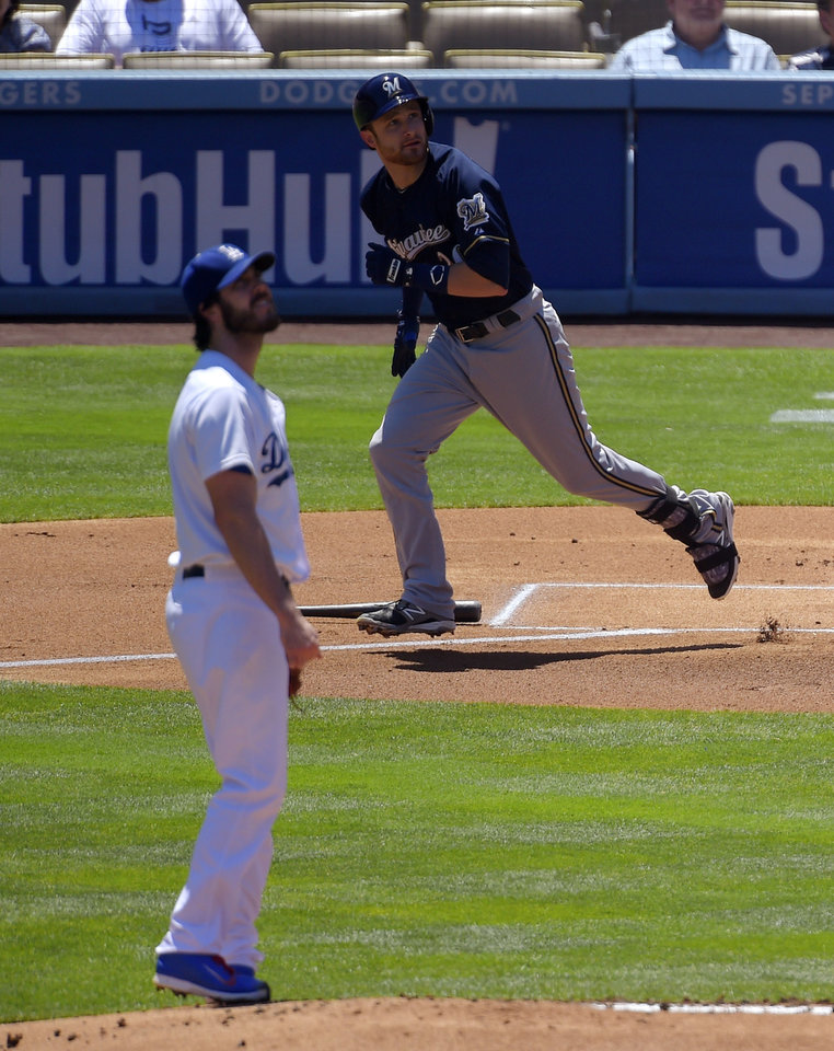 Photo - Milwaukee Brewers' Jonathan Lucroy, right, hits a two-run home run as Los Angeles Dodgers starting pitcher Dan Haren looks on during the first inning of a baseball game, Sunday, Aug. 17, 2014, in Los Angeles. (AP Photo/Mark J. Terrill)