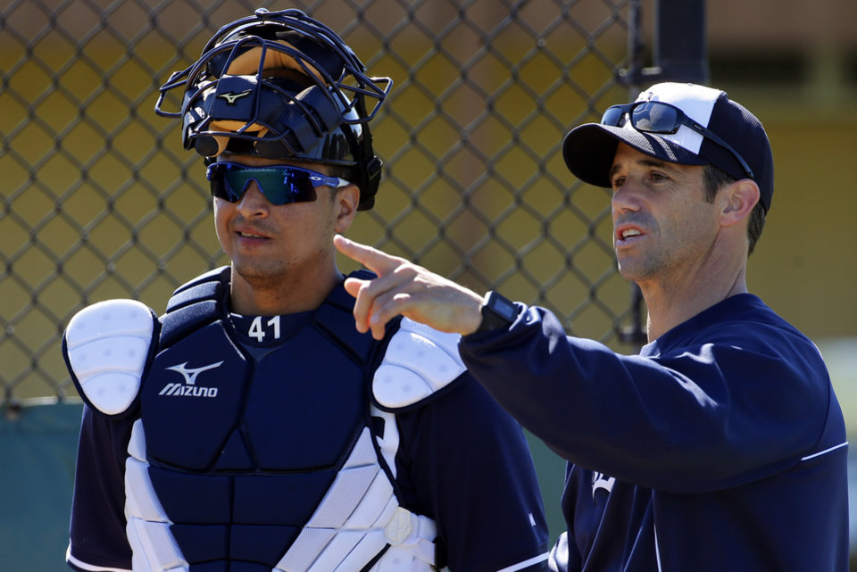 Photo - Detroit Tigers manager Brad Ausmus, right, talks with  Victor Martinez before a bullpen session on the team's first day of baseball spring training for pitchers and catchers, in Lakeland, Fla., Friday, Feb. 14, 2014. (AP Photo/Gene J. Puskar)