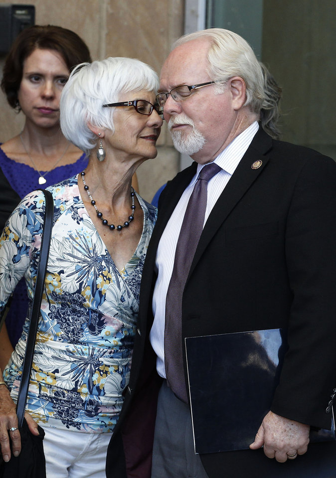 Photo -   U.S. Rep. Ron Barber, D-Ariz., right, shares a quiet moment with his wife Nancy Barber, as the two left court after shooter Jared Lee Loughner, who is accused of shooting the former congresswoman Gabrielle Giffords, and killing six people, and injuring 13 total, entered a plea agreement, sending Loughner to prison for the rest of his life, Tuesday, Aug. 7, 2012, in Tucson, Ariz. (AP Photo/Ross D. Franklin)