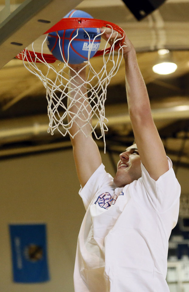 Photo - Thunder player Mitch McGary dunks during a visit to Thunder Youth Basketball Camp at Casady School in Oklahoma City, Wednesday, July 16, 2014. Photo by Nate Billings, The Oklahoman