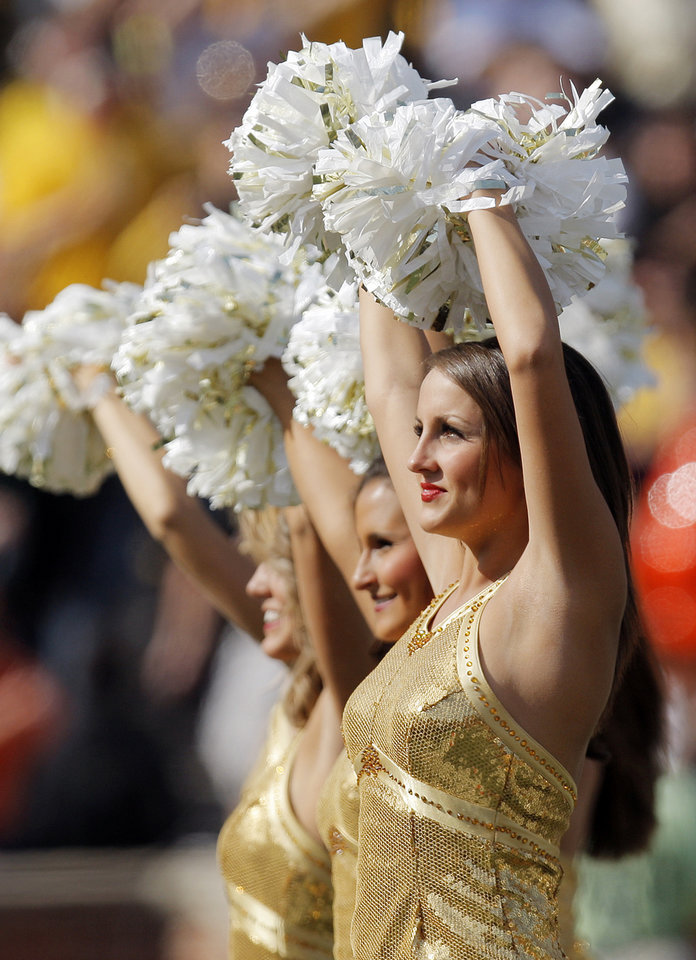 Photo - The Mizzou Golden Girls wave their arms during the