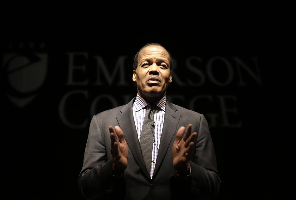 "In this Monday, Feb. 4, 2013 photo, Emerson College President Lee Pelton addresses an audience before the start of a public panel event called ""Made in America: Our Gun Violence Culture"" at Emerson College in Boston. Pelton was driving home with his 13-year-old daughter in the passenger seat when radio reports of the Newtown school massacre forced him over to side of the road. ""I held her hand as we listened...and we both cried,"" he said. (AP Photo/Steven Senne)"