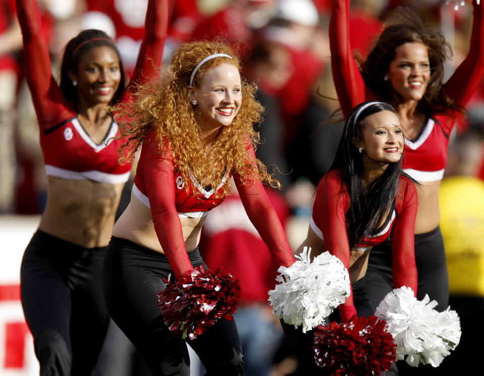 Photo - The OU Pom Pon Squad performs during the college football game between the Texas A&M Aggies and the University of Oklahoma Sooners (OU) at Gaylord Family-Oklahoma Memorial Stadium on Saturday, Nov. 5, 2011, in Norman, Okla. Photo by Bryan Terry, The Oklahoman