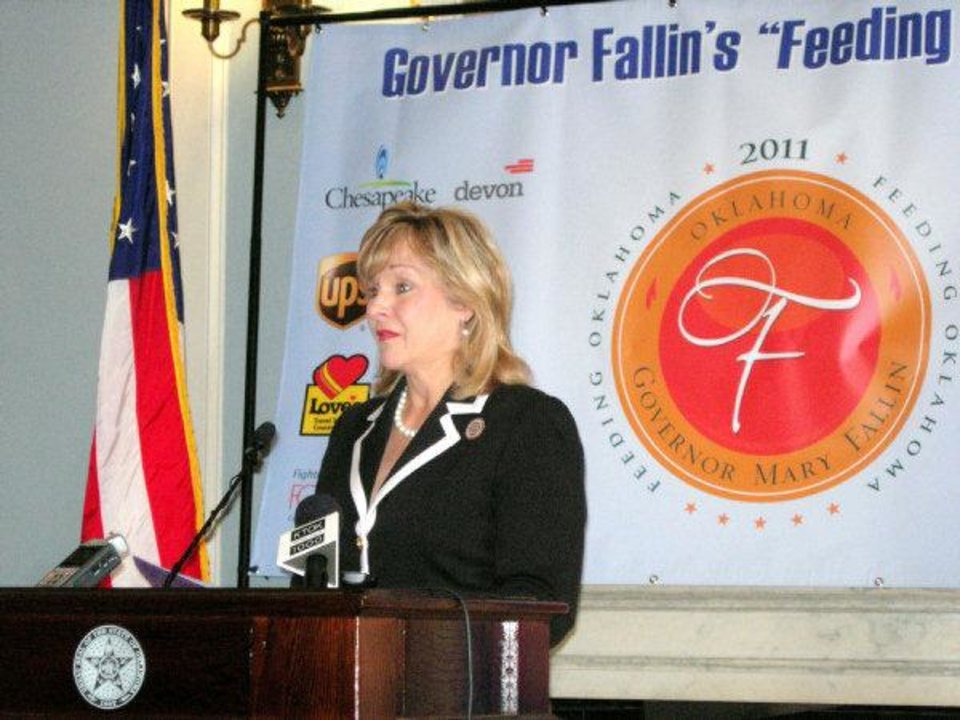 Photo - Gov. Mary Fallin announces Tuesday that enough food and money have been raised to provide about 1.6 million meals for Oklahomans.  Michael McNutt - THE OKLAHOMAN