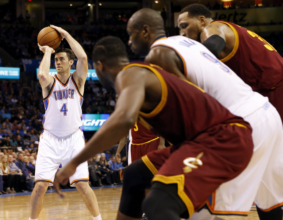 Photo - Oklahoma City's Nick Collison (4) takes a foul shot during an NBA basketball game between the Cleveland Cavaliers and the Oklahoma City Thunder at Chesapeake Energy Arena in Oklahoma City, Thursday, Dec. 11, 2014. Photo by Nate Billings, The Oklahoman
