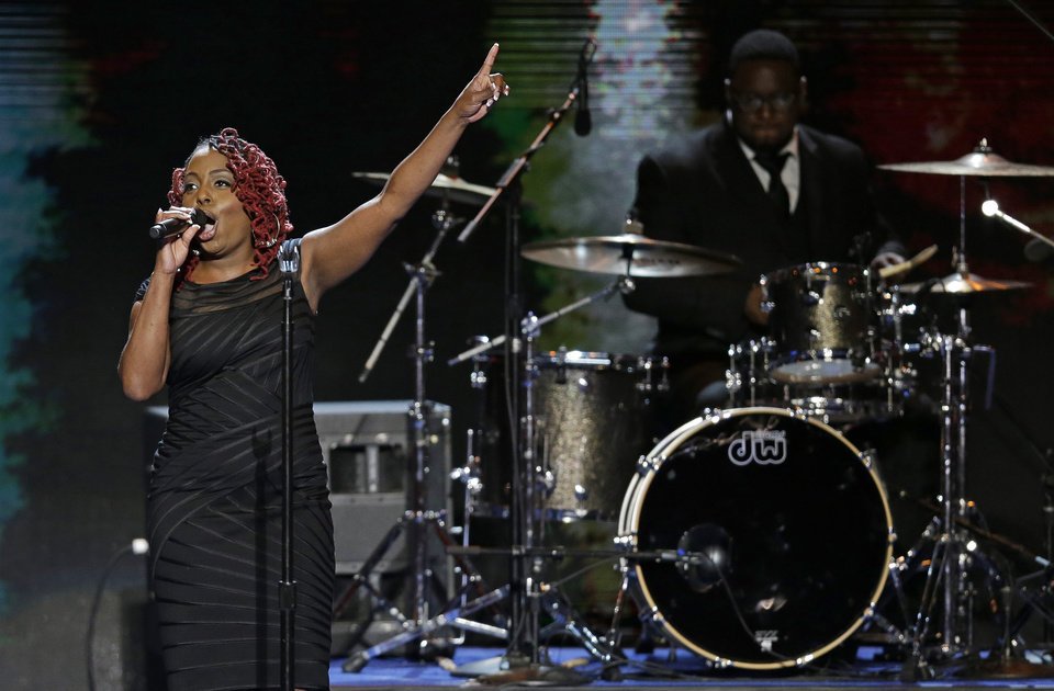 Photo - Singer Ledisi performs during the Democratic National Convention in Charlotte, N.C., on Tuesday, Sept. 4, 2012. (AP Photo/J. Scott Applewhite)  ORG XMIT: DNC146