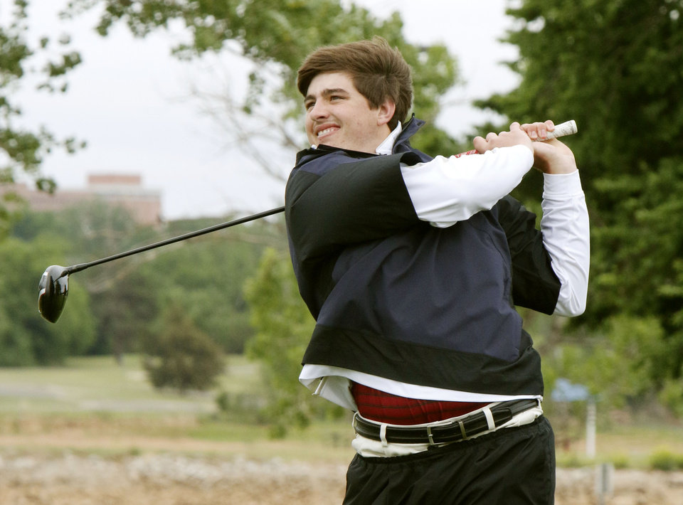 Photo - Weatherford's Quade Cummins tees off during the class 4A boy's state golf tournament at the Lake Hefner Golf Course in Oklahoma City, OK, Monday, May 12, 2014,  Photo by Paul Hellstern, The Oklahoman