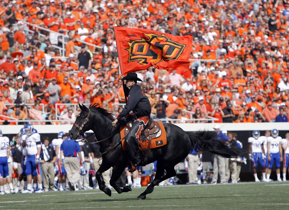 Photo - Bullet celebrates a touchdown during the first half of the college football game between the Oklahoma State University Cowboys (OSU) and the University of Kansas Jayhawks (KU) at Boone Pickens Stadium in Stillwater, Okla., Saturday, Oct. 8, 2011. Photo by Sarah Phipps, The Oklahoman