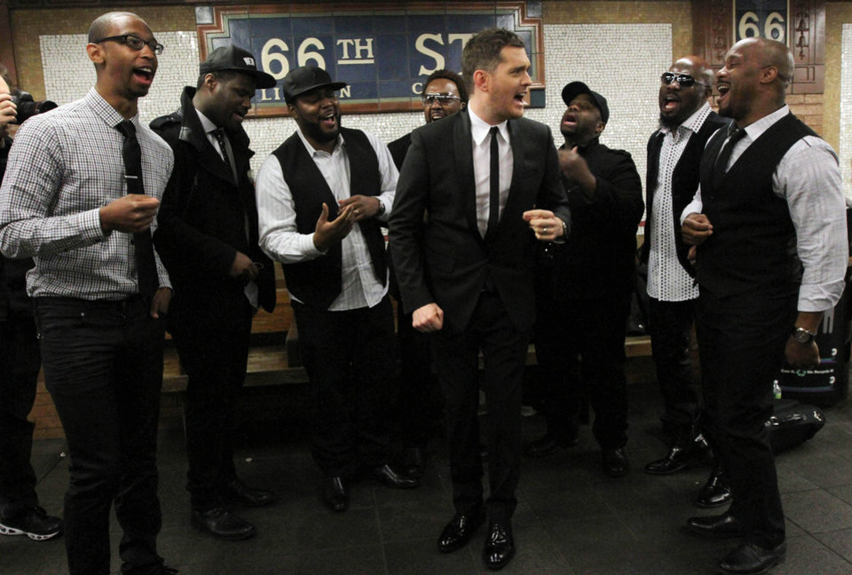 Photo - In this photo provided by Transit Wireless, Canadian crooner Michael Buble, center, and the acappella group Naturally 7 perform a song from Buble's just released album