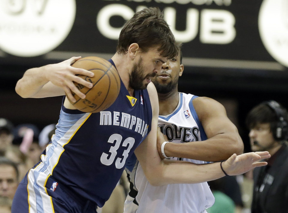 Memphis Grizzlies\' Marc Gasol, left, of Spain, makes his way past Minnesota Timberwolves\' Derrick Williams in the first quarter of an NBA basketball game on Saturday, March 30, 2013, in Minneapolis. (AP Photo/Jim Mone)