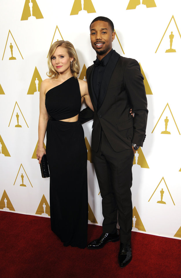 Photo - Evening co-hosts Kristen Bell, left, and Michael B. Jordan pose together before the Academy of Motion Picture Arts and Sciences' annual Scientific and Technical Awards on Saturday, Feb. 15, 2014, in Beverly Hills, Calif. (Photo by Chris Pizzello/Invision/AP)