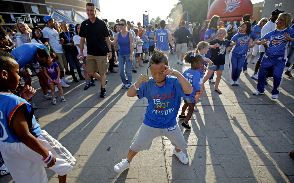 Photo - Joey Talaoc, 8, of Yukon dances before Game 2 of the NBA Finals between the Oklahoma City Thunder and the Miami Heat at Chesapeake Energy Arena in Oklahoma City, Thursday, June 14, 2012. Photo by Bryan Terry, The Oklahoman