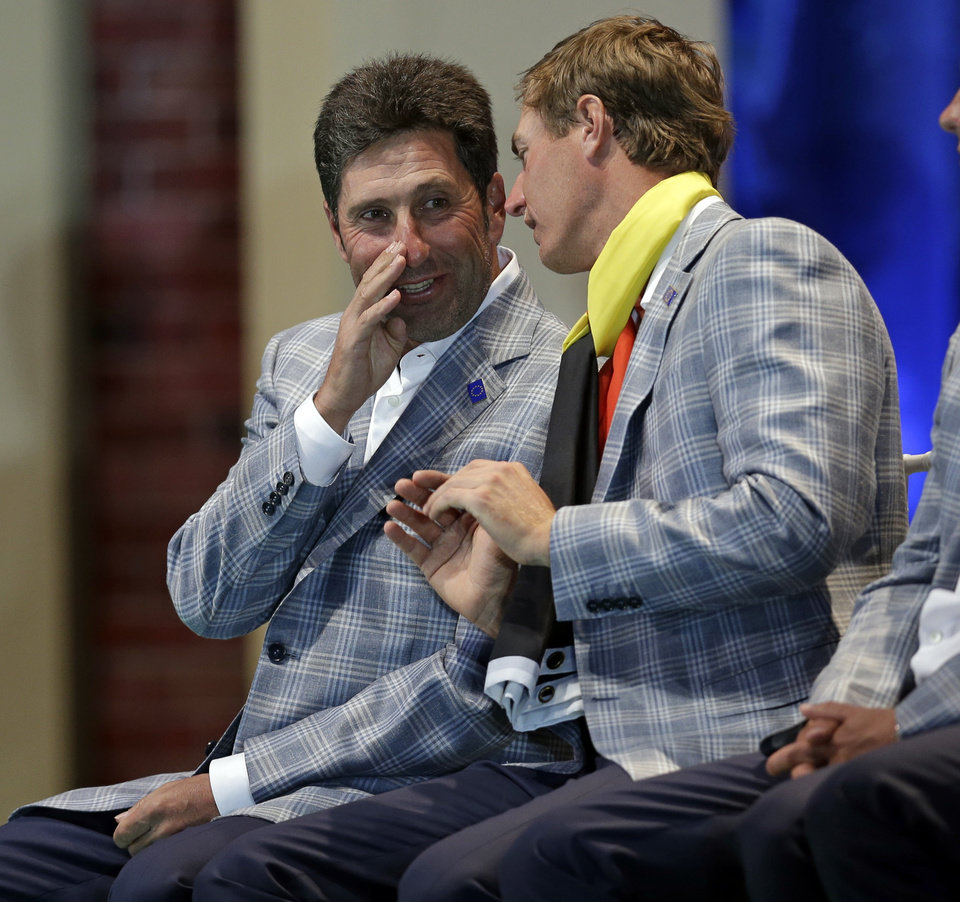 Europe's Nicolas Colsaerts, right, talks to team captain Jose Maria Olazabal at the closing ceremony for the Ryder Cup PGA golf tournament Sunday, Sept. 30, 2012, at the Medinah Country Club in Medinah, Ill. (AP Photo/David J. Phillip)  ORG XMIT: PGA247