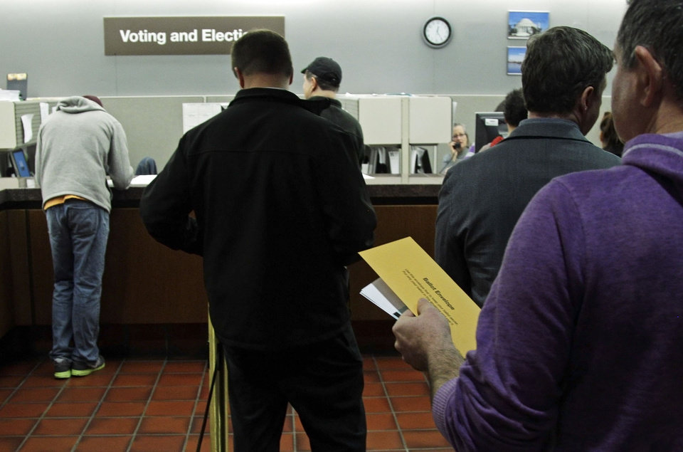 Photo -   Early voters line up to cast absentee ballots at the Hennepin County Government Center Monday, Nov. 5, 2012 in Minneapolis. (AP Photo/Jim Mone)