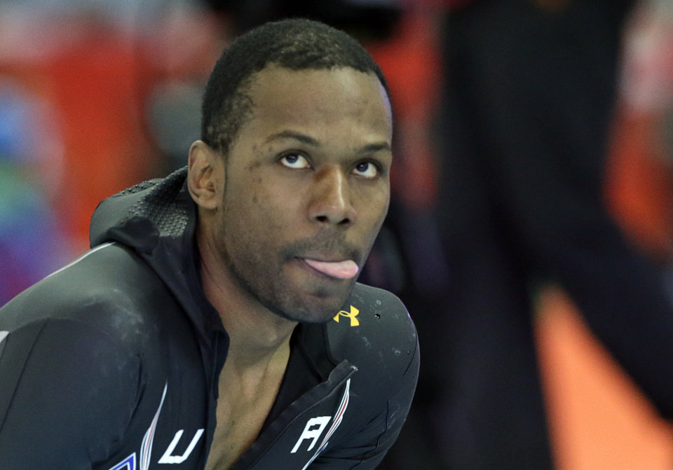 Photo - Shani Davis of the U.S. looks up at the screen to see his performance timing after the second heat of the men's 500-meter speedskating race at the Adler Arena Skating Center during the 2014 Winter Olympics, Monday, Feb. 10, 2014, in Sochi, Russia. (AP Photo/Matt Dunham)