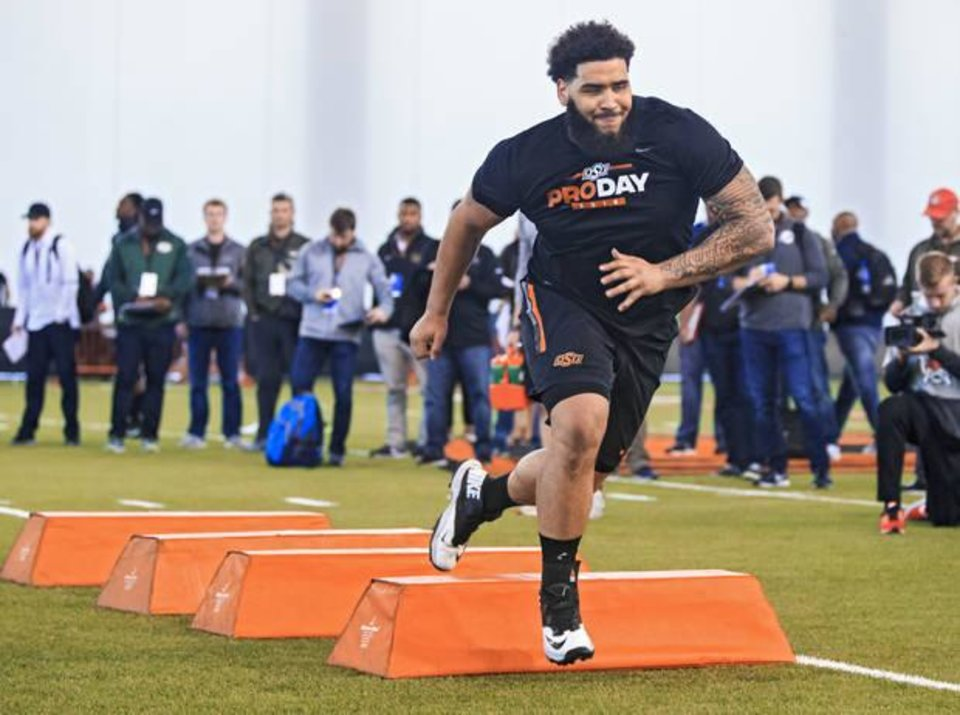 Photo -  Oklahoma State offensive lineman Larry Williams participated in Pro Day at OSU's Sherman Smith Training Center on Thursday, despite not knowing if he'll be returning for an additional year with the Cowboys or heading to professional football next season. [PHOTO BY CHRIS LANDSBERGER, THE OKLAHOMAN]