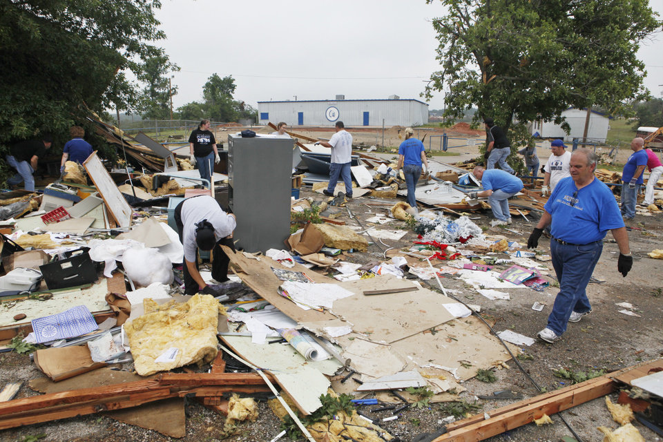 Photo - Students, teachers and administrators sifts the debris of portable classroom  at Little Axe School, Tuesday, May 11, 2010. The school was hit by a tornado Monday, May 10, 2010. Photo by David McDaniel, The Oklahoman