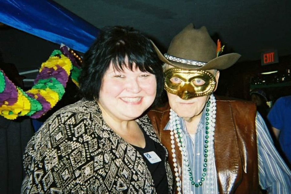 "(from left) Shange Loyd, adminstrator, and Oliver ""Cowboy"" Lamb, a resident at Grace Living Center - El Reno enjoy Mardi Gras festivities. Residents help plan the annual event.<br/><b>Community Photo By:</b> Amber Wright<br/><b>Submitted By:</b> Tilford, Oklahoma City"