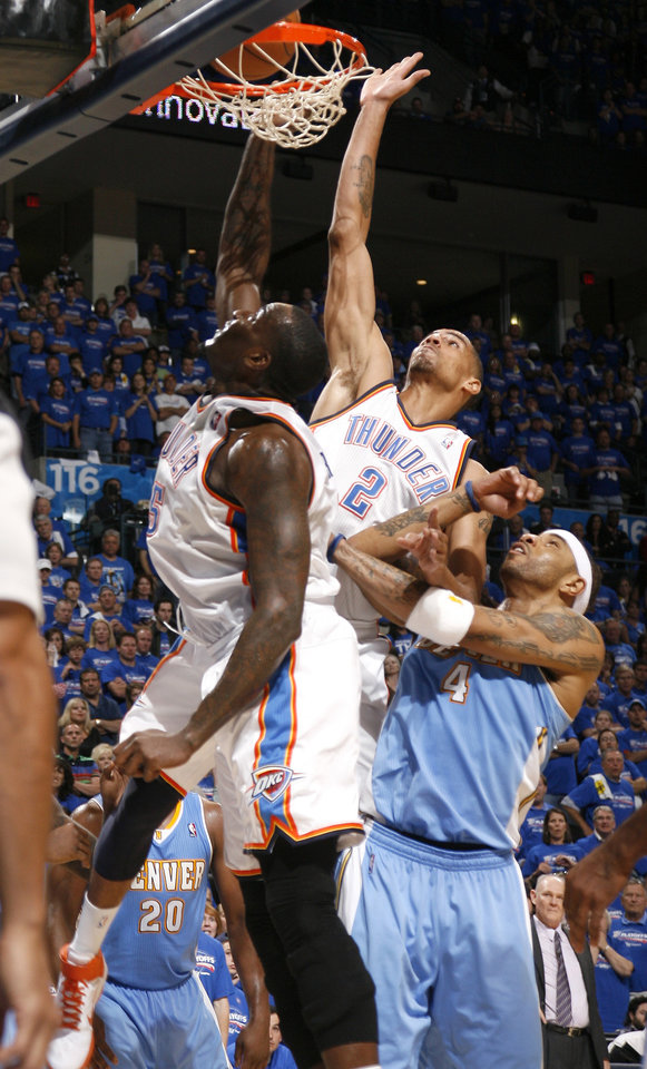 Oklahoma City\'s Kendrick Perkins (5) and Thabo Sefolosha (2) tip the ball in in front of Denver\'s Kenyon Martin (4) in the final minutes of the NBA basketball game between the Denver Nuggets and the Oklahoma City Thunder in the first round of the NBA playoffs at the Oklahoma City Arena, Sunday, April 17, 2011. Photo by Bryan Terry, The Oklahoman