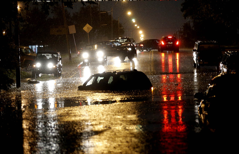 Photo - Cars are flooded on S. May Ave near SW 25th in Oklahoma City, Friday, May 31, 2013. Photo by Sarah Phipps, The Oklahoman.