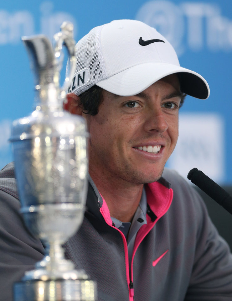 Photo - Rory McIlroy of Northern Ireland attends a press conference after winning the British Open Golf championship at the Royal Liverpool golf club, Hoylake, England, Sunday July 20, 2014. (AP Photo/Jon Super)