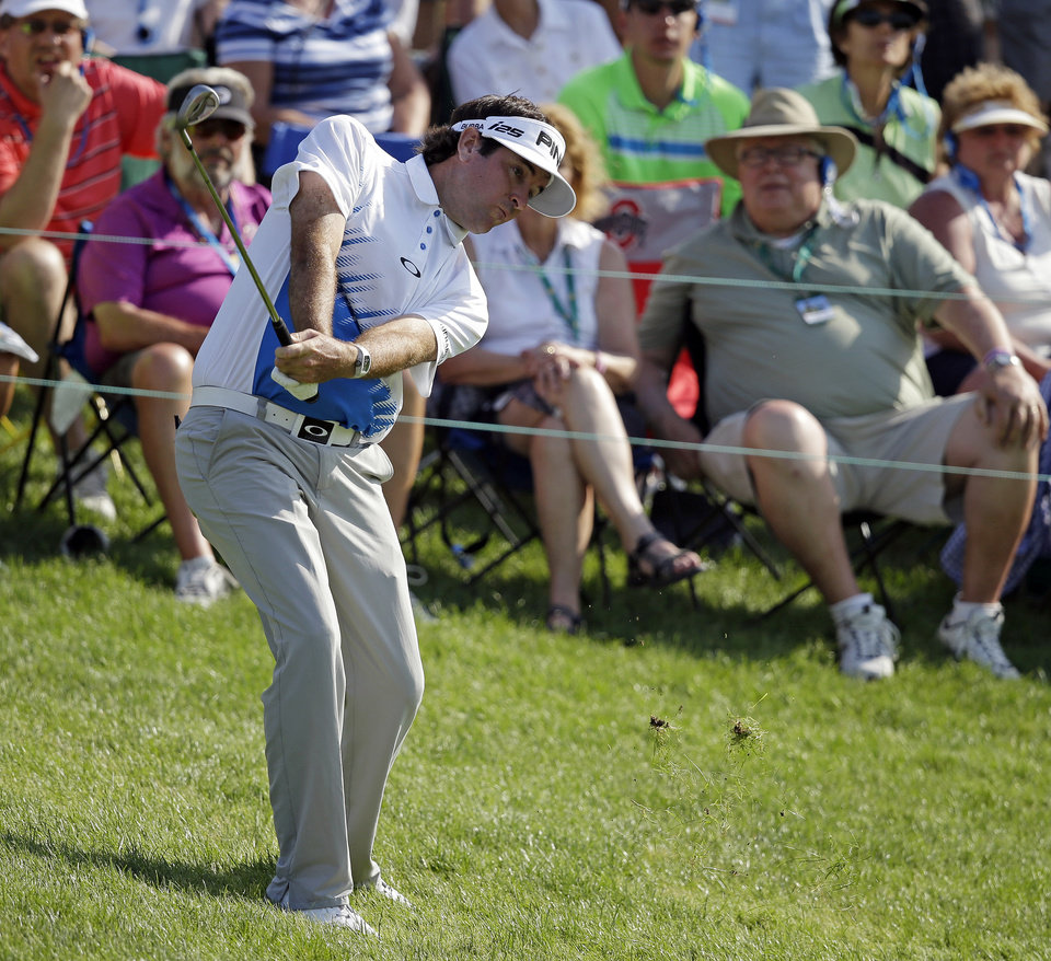Photo - Bubba Watson hits to the 18th green during the third round of the Memorial golf tournament Saturday, May 31, 2014, in Dublin, Ohio. (AP Photo/Darron Cummings)