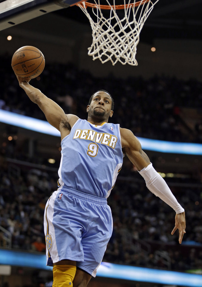 Photo - Denver Nuggets' Andre Iguodala soars in for a dunk against the Cleveland Cavaliers in the first quarter of an NBA basketball game Saturday, Feb. 9, 2013, in Cleveland. (AP Photo/Mark Duncan)