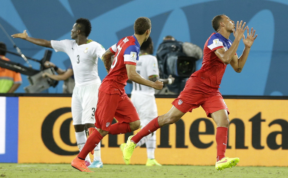 Photo - United States' John Brooks, right, celebrates after scoring his side's second goal during the group G World Cup soccer match between Ghana and the United States at the Arena das Dunas in Natal, Brazil, Monday, June 16, 2014.   (AP Photo/Dolores Ochoa)