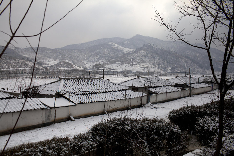 In this Feb. 22, 2013 photo, homes are blanketed with snow in the village of Ryongsan-ri, North Hwanghae province, about 40 km (25 miles) southeast of Pyongyang, North Korea. (AP Photo/David Guttenfelder)