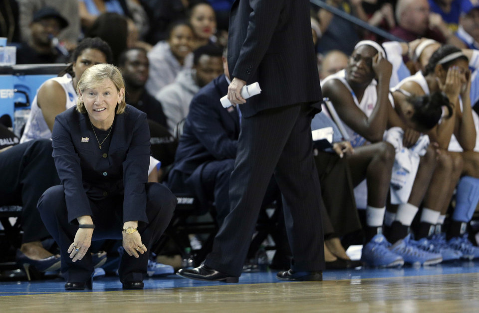 North Carolina head coach Sylvia Hatchell, left, reacts after officials called a foul on North Carolina during the second half of a second-round game against Delaware in the women's NCAA college basketball tournament in Newark, Del., Tuesday, March 26, 2013. Delaware won 78-69. (AP Photo/Patrick Semansky)